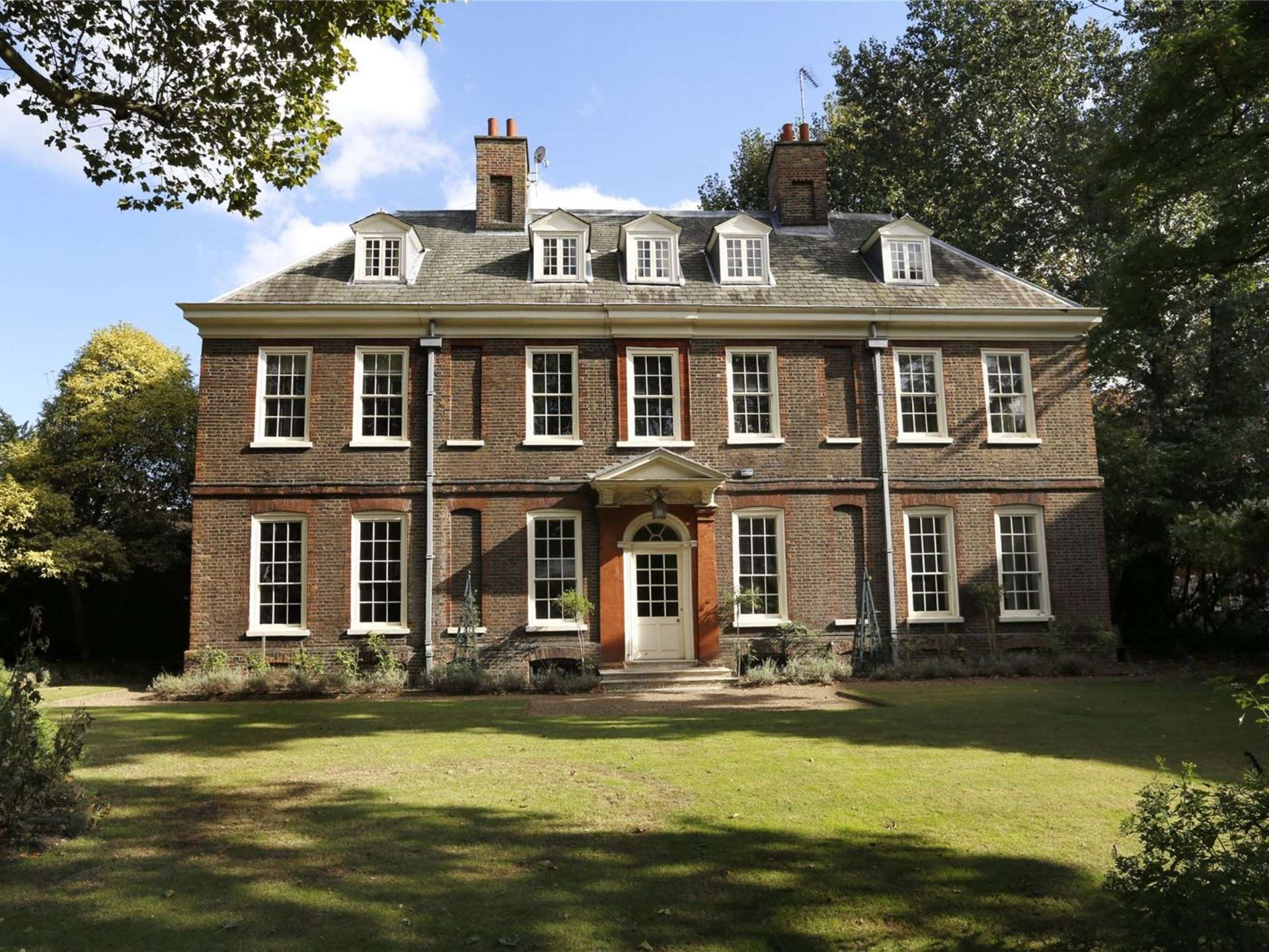 A unique opportunity to acquire an historic and handsome ten bedroomed manor house situated just over the river thames from chelsea